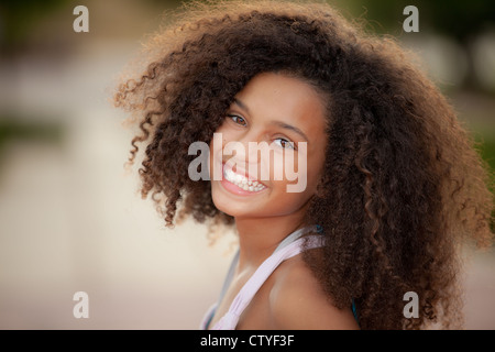 happy smiling african descent child with afro hair style - Stock Photo