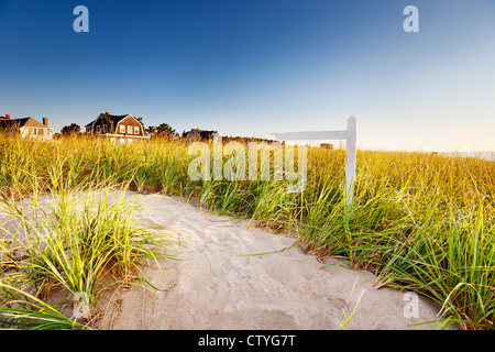 Path through dunes with signpost - Stock Photo