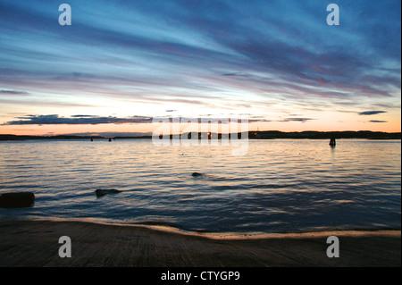 Sunset on lake Pielinen, Finland. - Stock Photo