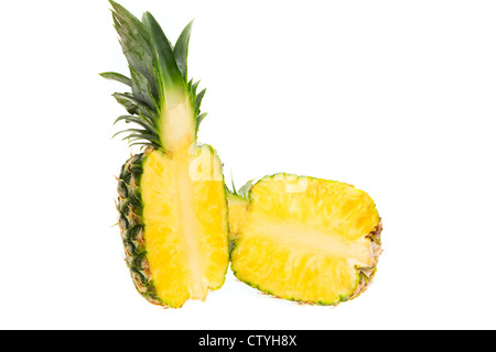 Fresh pineapple cut in half - studio shot with a white background - Stock Photo