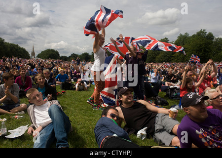 British spectators celebrate a gold medal win by Team GB Triathlete Alistair Brownlee in the Triathlon, held in - Stock Photo