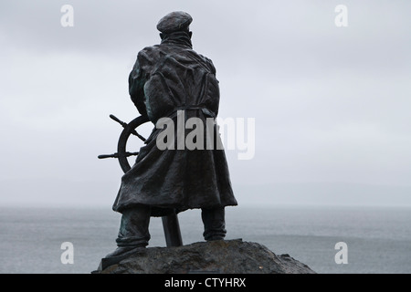 Statue of coxswain Richard 'Dic' Evans, RNLI Seawatch Centre, Moelfre, Anglesey, Wales - Stock Photo