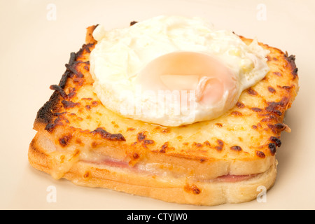Classic French toasted sandwich or Croque Madame with a fried egg on top of the toasted cheese - studio shot - Stock Photo