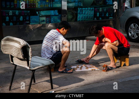 People playing Chinese Checkers in Beijing - Stock Photo