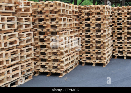 stacks of wooden pallets ready to be used to transport goods Puy de Dome Auvergne Massif Central France - Stock Photo