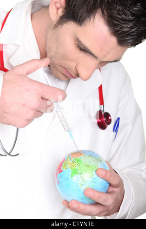 physician injecting drug to globe - Stock Photo