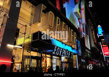 Night neon oblique view, towards West 45th Street, electric lights Forever 21 boutique store, 7th Avenue, Times - Stock Photo