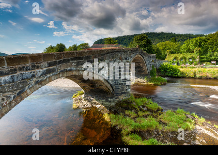 17th century stone bridge over the River Conwy at Llanrwst with the ivy-clad Tu Hwnt i'r Bont National Trust tearooms - Stock Photo