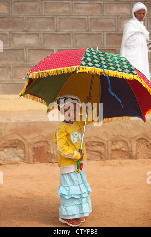 Young African girl with umbrella - Stock Photo