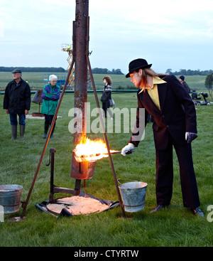 Men Lighting The Fire Garden Stonehenge UK - Stock Photo