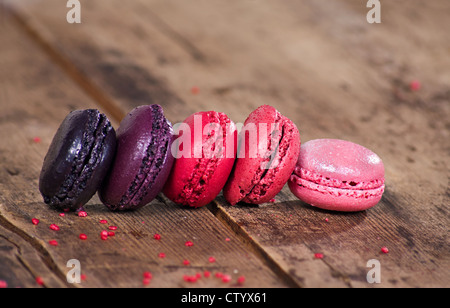 Macaroons on a wooden rustic table - Stock Photo