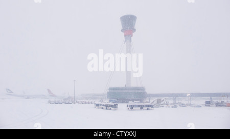 Air control tower and airport in snow - Stock Photo