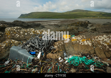 Sea landscape with plastic waste on the shore - Stock Photo