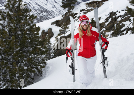 Skier standing on snowy slope - Stock Photo