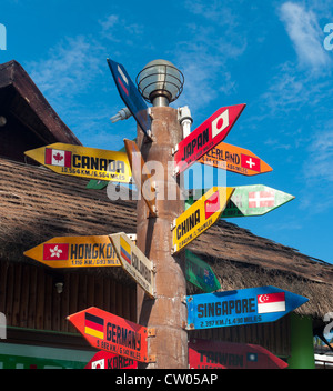 signpost with countries of the world on Boracay island, Philippines - Stock Photo