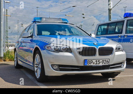 BMW and VW Volkswagen police patrol cars of the German Federal Police (Bundespolizei) - Heilbronn Germany - Stock Photo