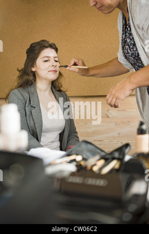Make up artist working on client - Stock Photo
