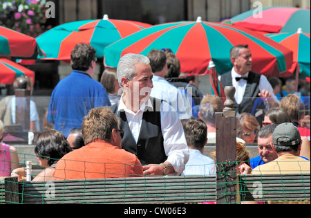 Brussels, Belgium. Outdoor cafe in the Grand Place - Stock Photo