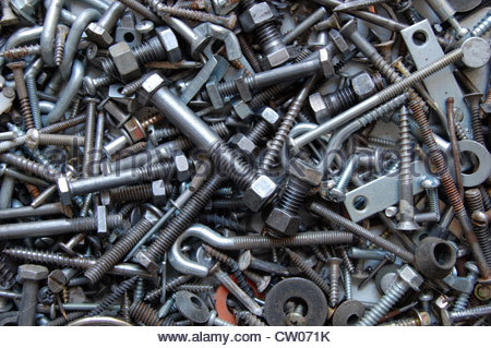 Closeup studio shot pile of assorted metal nuts, bolts, washers, and screws. Collection of fasteners. - Stock Photo