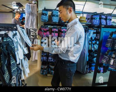 paris france chinese man shopping walking away inside luxury stock photo royalty free image. Black Bedroom Furniture Sets. Home Design Ideas
