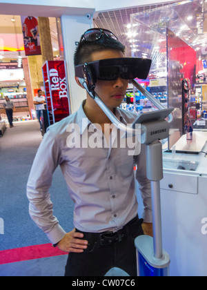Paris, France, Chinese Man Using Three Dimensional Glasses 3D for High Definition T.V. in VIrgin Store, (Closed) - Stock Photo