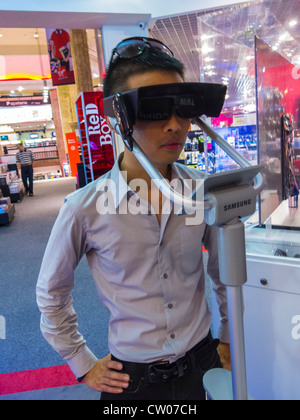 Paris, France, Chinese Man Using Three Dimensional Glasses 3D for High Definition T.V. in VIrgin Store, People using - Stock Photo
