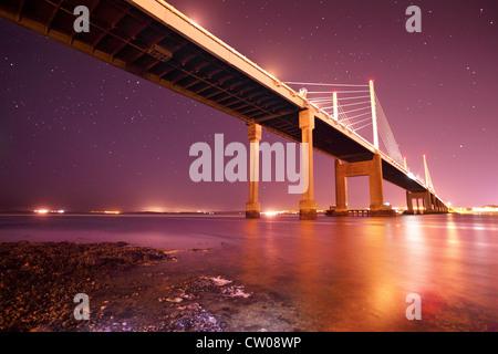 Star filled night across the Moray Firth and Kessock Bridge Highland Scotland