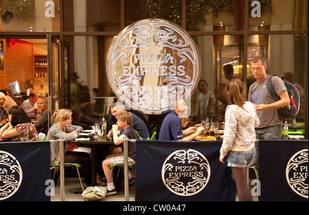 People eating at a Pizza Express restaurant, O2 arena, london UK - Stock Photo