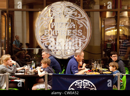 People eating a meal at Pizza express restaurant O2 arena, london UK - Stock Photo