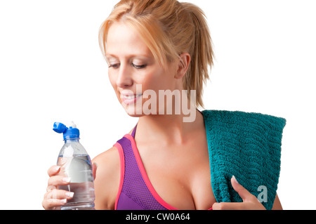 Woman about to drink water from a plastic bottle, isolated in white - Stock Photo