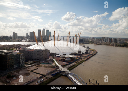 Aerial view of The O2 arena, Canary Wharf in the background, River Thames, London UK - Stock Photo