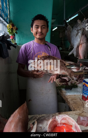 Man with fresh catch in fish market, Merida, Mexico. - Stock Photo