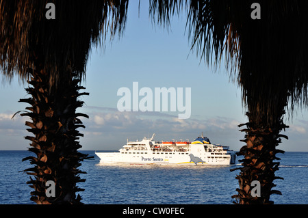 Portugal - Madeira - Funchal - white ferry boat to Porto Santo island - off Madeira - catching early sunlight  framed - Stock Photo
