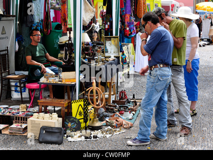 Portugal - Madeira - Funchal Zona velha - stall in street market - buyers contemplating a possible purchase - Stock Photo