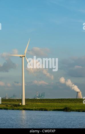 Wind turbine with nuclear smokestack - Stock Photo