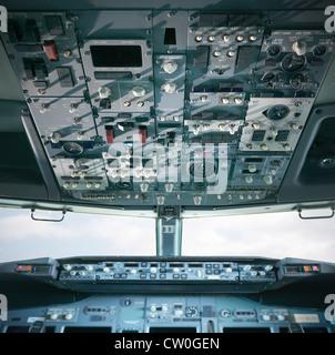Empty cockpit of jet airplane - Stock Photo