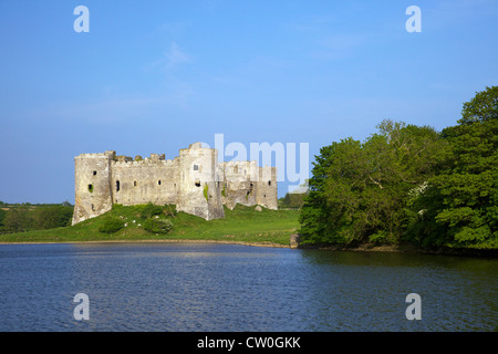 Carrew ruined castle in  spring sunshine Pembrokeshire National Park, West Wales, Cymru, UK, United Kingdom, GB - Stock Photo