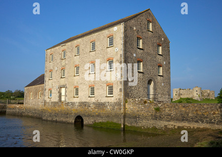 Carrew tidal mill and Castle in  spring sunshine Pembrokeshire National Park, West Wales, Cymru, UK, United Kingdom, - Stock Photo