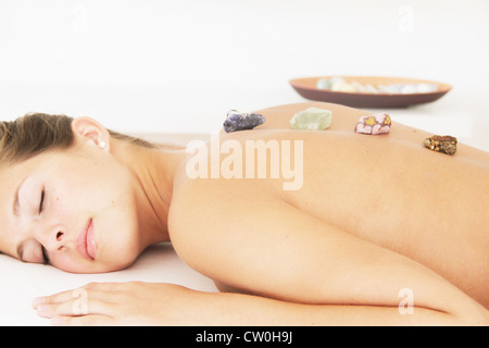 Woman having hot stone massage in spa - Stock Photo