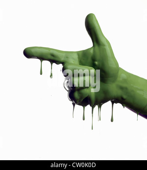 Green painted hand pointing - Stock Photo