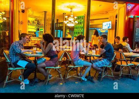 Paris, France,Young Couples Eating in Paris Café, Bistro Restaurant, 'Café Le Bistro' in the Canal Saint Martin - Stock Photo