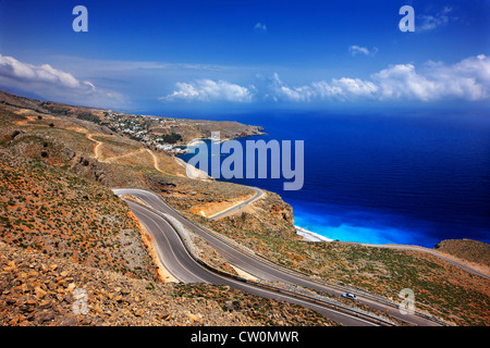 The road to Anopolis and Araden villages. In the background, Chora Sfakion. Sfakia, Chania, Crete, Greece - Stock Photo