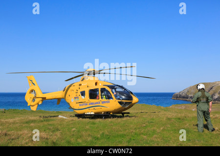 Scottish Air Ambulance Service Helicopter preparing to take off after a rescue mission on remote North West Highlands - Stock Photo