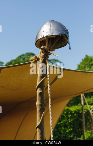 Replica early mediaeval helmet on a post. St Albans, UK. May 2012 - Stock Photo
