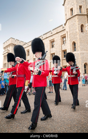 Royal Scots guards marching in front of the Jewel House at the changing of the guard. Tower of London UK - Stock Photo