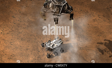 artist's concept the moment immediately after NASA's Curiosity rover touches down onto the Martian surface in Gale - Stock Photo