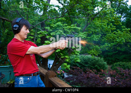 Man Shooting a .22 SSemi-automatic Pistol - Stock Photo