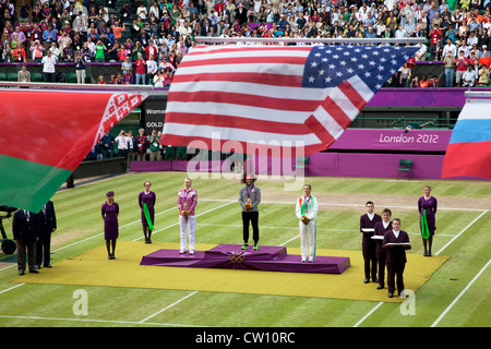 Crowds watch in Centre Court as the Tennis events at the London 2012 Olympics take place at Wimbledon. Womens final - Stock Photo
