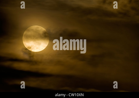 Full Moon and Wispy Clouds - Stock Photo