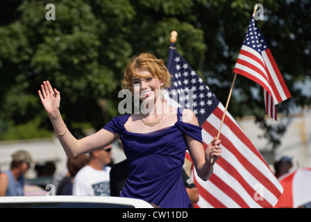 Queen Candidate Waving Flag in Independence Day Parade in New Pekin, Indiana - Stock Photo